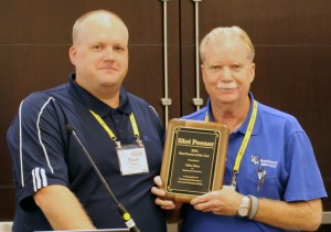 Dave Barkley (left) awarded Mike Wern (right) the 2014 Shot Peener of the Year award.`